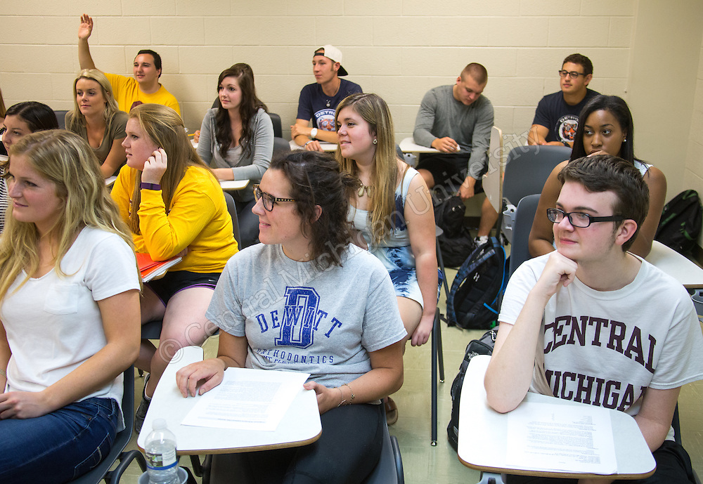 Students listen as their professor Joe Packer speaks during COM 267 on the first day of school in Moore Hall room 212 on the campus of Central Michigan University in Mount Pleasant, Mich. Monday, Aug 31, 2015.