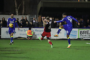 AFC Wimbledon midfielder Tom Soares (14) shoots at goal during the EFL Sky Bet League 1 match between AFC Wimbledon and Coventry City at the Cherry Red Records Stadium, Kingston, England on 14 February 2017. Photo by Stuart Butcher.
