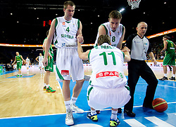 Uros Slokar of Slovenia and Matjaz Smodis of Slovenia helping Goran Dragic of Slovenia during basketball game between National basketball teams of Slovenia and Lithuania at of FIBA Europe Eurobasket Lithuania 2011, on September 15, 2011, in Arena Zalgirio, Kaunas, Lithuania.  (Photo by Vid Ponikvar / Sportida)