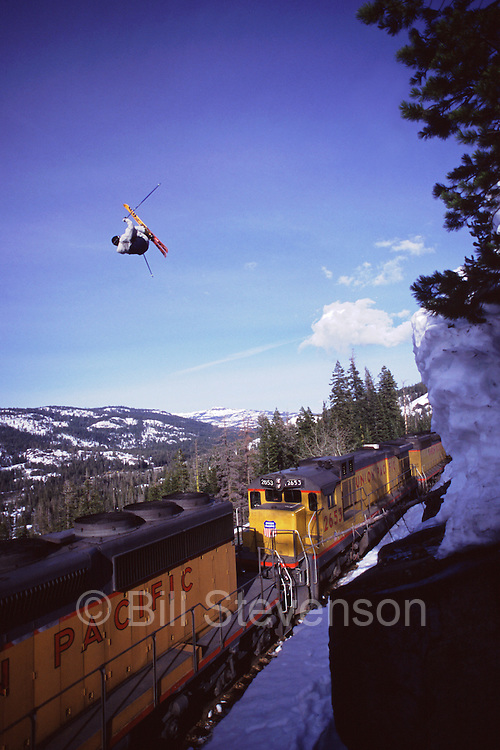 A photo of a skier jumping over a train in Cisco Grove, Ca.