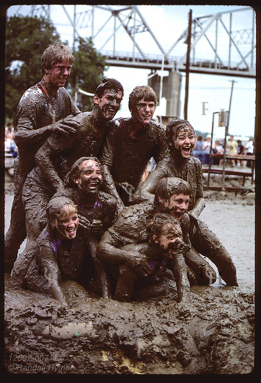 Muddy team poses for photo after game; Mississippi Mud Volleyball Tourney/Tom Sawyer Days;Hannibal Missouri