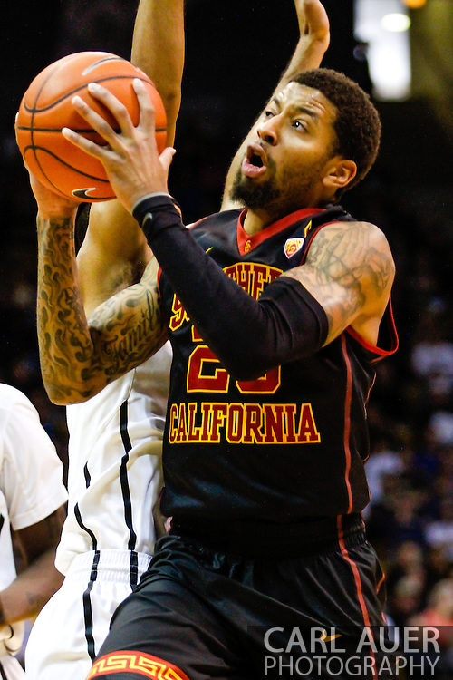 January 18th, 2014:  USC Trojans senior guard J.T. Terrell (20) heads to the hoop for a shot attempt in the first half of action in the NCAA Basketball game between the USC Trojans and the University of Colorado Buffaloes at the Coors Events Center in Boulder, Colorado