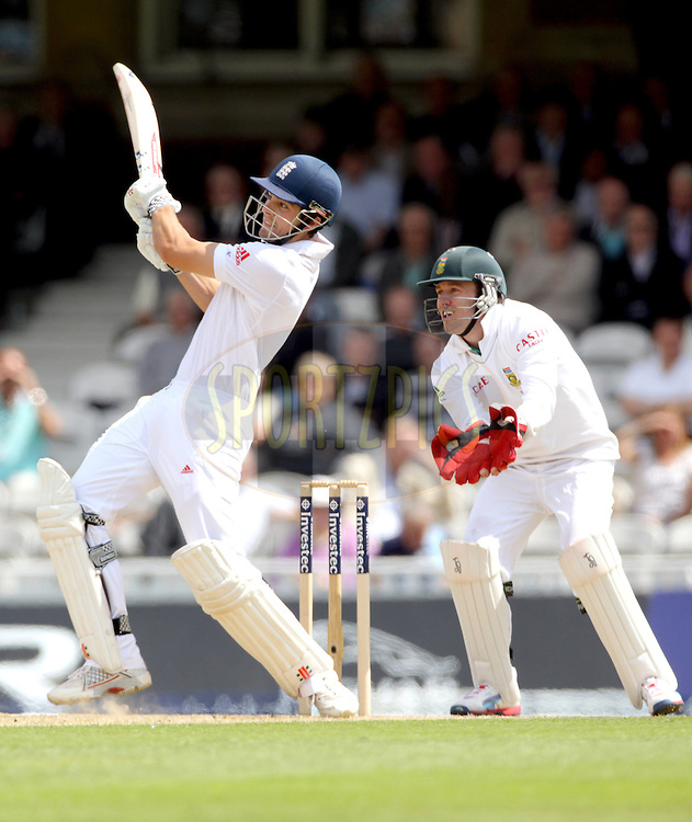 © Andrew Fosker / Seconds Left Images 2012 - England's Alastair Cook pulls South Africa's Imran Tahir for four to reach his half century , 50 , fifty -  South Africa's AB de Villiers (wk) (RT)  England v South Africa - 1st Investec Test Match -  Day 1 - The Oval  - London - 19/07/2012