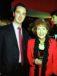 MR PIERS NIMMO and his mother MRS DEREK NIMMO widow of the actor, at a party in London on 3rd November 1999.MYN 19