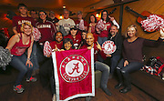 Alabama fans gather in Belltown, Monday, Dec. 19, 2016, in Seattle, for a pre-Peach Bowl portrait at the Belltown Pub, where many will watch the game against the University of Washington. <br />