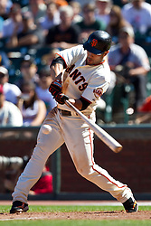 May 30, 2010; San Francisco, CA, USA;  San Francisco Giants center fielder Andres Torres (56) hits a single against the Arizona Diamondbacks during the ninth inning inning at AT&T Park.