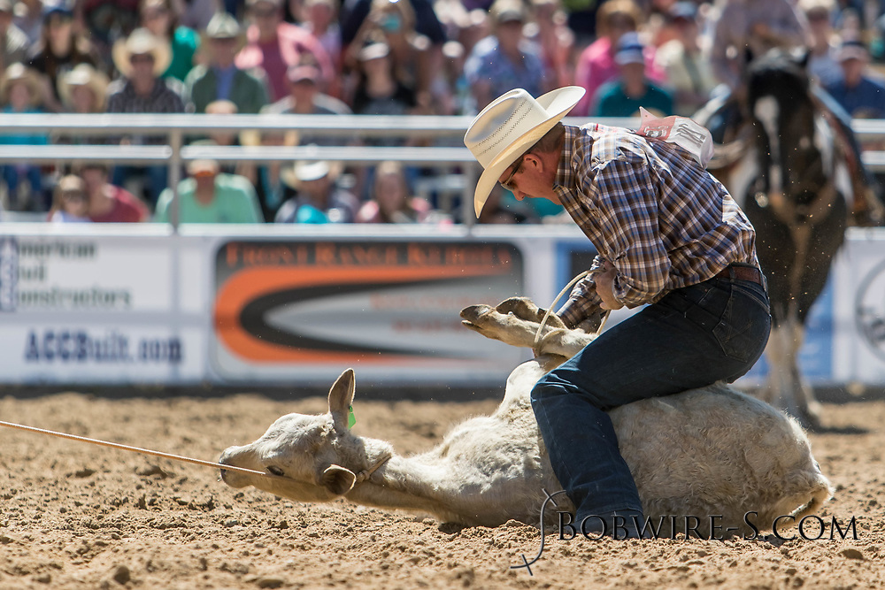 Tie-down roper Ryan Watkins makes his run in the first performance of the Elizabeth Stampede on Saturday, June 2, 2018.