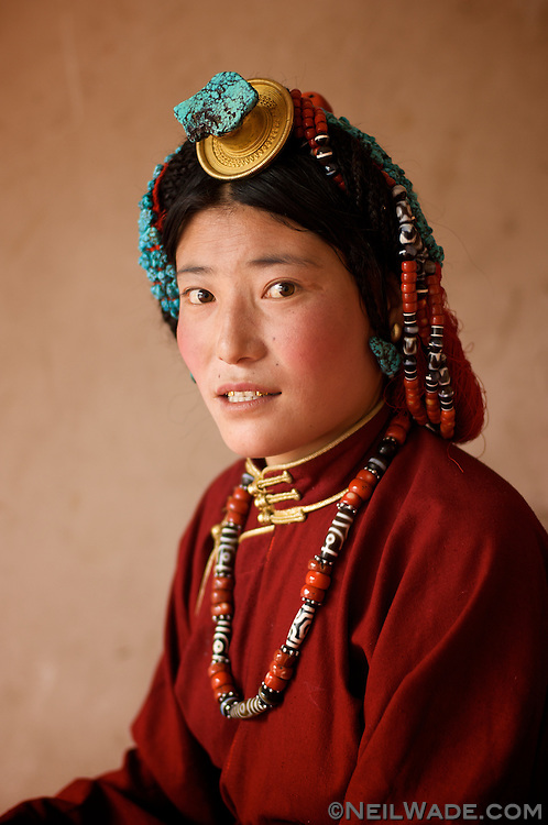 This woman is dressed in typical Kham-Tibetan jewelry. She's smiling strangely because she wants to make sure you can see her gold teeth...A definite fashion must-have in Tibet.