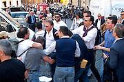 2013/04/19 Roma, manifestazioni in piazza Montecitorio durante il secondo giorno delle lezioni del Presidente della Repubblica. Nella foto militanti di destra si affrontano con schiaffi, spinte e insulti.<br /> Rome, demo at Parliament Square, during second election day for the president of the republic. In the picture militants of the right-wing and left-wing clash with slapping, pushing and insults - &copy; PIERPAOLO SCAVUZZO