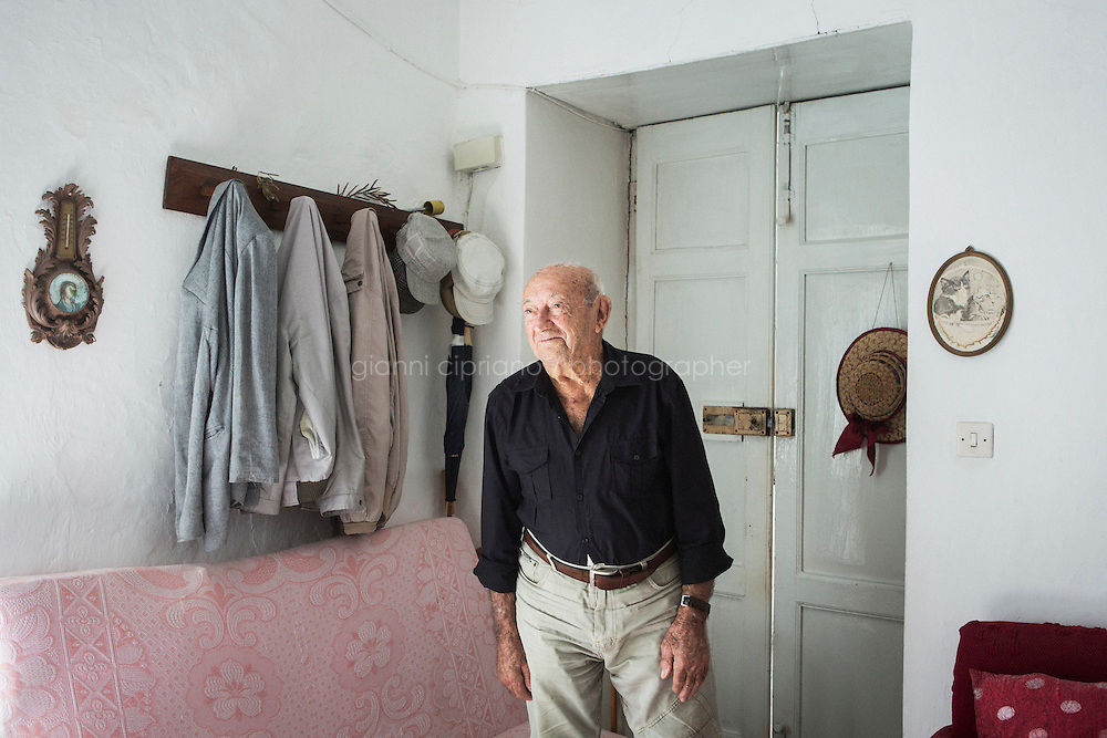 ACCIAROLI (POLLICA), ITALY - 5 OCTOBER 2016:  94-years-old Giuseppe Vassallo poses for a portrait in his house in Acciaroli, a hamlet in the municipality of Pollica, Italy, on October 5th 2016. Giuseppe Vassallo was an Italian Navy official during WWII. At age 86, 8 years ago, Mr Vassallo had multiple sex affairs to overcome his depression following his wife's death. He was a testimonial of the Acciaroli's mediterranean  diet and lifestyle during Expo 2015, the Universal Exposition hostel in Milan last year.<br /> <br /> To understand how people can live longer throughout the world, researchers at University of California, San Diego School of Medicine have teamed up with colleagues at University of Rome La Sapienza to study a group of 300 citizens, all over 100 years old, living in Acciaroli (Pollica), a remote Italian village nestled between the ocean and mountains in Cilento, southern Italy.<br /> <br /> About 1-in-60 of the area&rsquo;s inhabitants are older than 90, according to the researchers. Such a concentration rivals that of other so-called blue zones, like Sardinia and Okinawa, which have unusually large percentages of very old people. In the 2010 census, about 1-in-163 Americans were 90 or older.