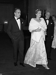 PRINCE RAINIER & PRINCESS GRACE OF MONACO seated at the Monte Carlo Rose Ball on 7th February 1958.