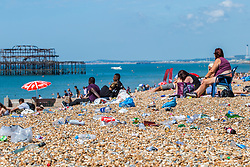 © Licensed to London News Pictures. 05/08/2016. Brighton, UK. Wate, including glass bottles and plastic bags , left by revellers overnight after the Brighton Pride are littered across the beach in Brighton. Members of the public were left stranded in Brighton and Hove as chaos took hold in Brighton station. Photo credit: Hugo Michiels/LNP