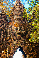 One of the gates adorned with stone faces, Angkor Tom (Angkor Wat complex), Cambodia.