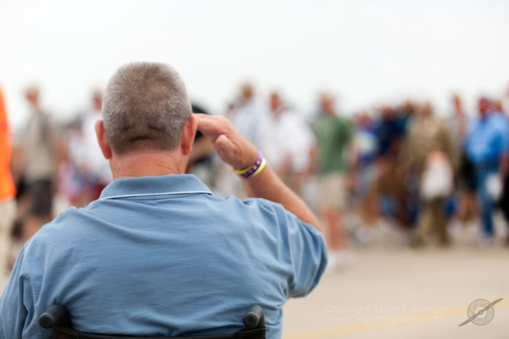 Vietnam Veteran Jim Sursely salutes the Parade of Veterans...Disabled American Veterans Parade activities involving Vietnam Veteran and triple-amputee, Jim Sursely, B-25 'Panchito' owner and pilot, Larry Kelley and actor Gary Sinise.