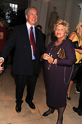 SIR MARK WEINBERG and DAME VIVIEN DUFFIELD at a reception to present the new Cartier Tank Watch Collection held at The Orangery, Kensington Palace Gardens, London W8 on 19th April 2012.