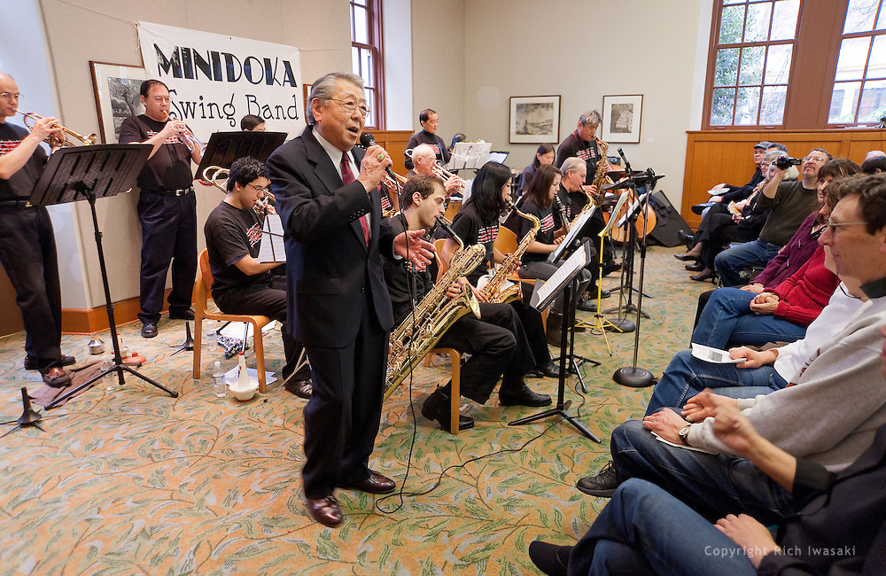 "Vocalist Henry ""Shig"" Sakamoto performs with the Minidoka Swing Band in the US Bank Room of Multnomah County Library - Central branch, Portland, Oregon. Mr. Sakamoto was a former internee at Minidoka."