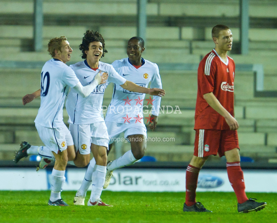 WARRINGTON, ENGLAND - Thursday, March 12, 2009: Manchester United's Fabio Da Silva celebrates scoring his side's second goal against Liverpool during the FA Premiership Reserves League (Northern Division) match at the Halliwell Jones Stadium. (Photo by David Rawcliffe/Propaganda)