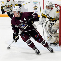 "TRENTON, ON  - MAY 3,  2017: Canadian Junior Hockey League, Central Canadian Jr. ""A"" Championship. The Dudley Hewitt Cup. Game 3 between Powassan Voodoos and the Dryden GM Ice Dogs. Woody Galbraith #18 of the Dryden GM Ice Dogs skates up the ice during the second period.<br /> (Photo by Andy Corneau / OJHL Images)"