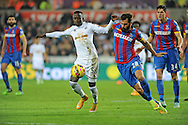 Modou Barrow of Swansea City is tackled by Joe Ledley of Crystal Palace.<br /> Barclays Premier league match, Swansea city v Crystal Palace at the Liberty stadium in Swansea, South Wales on Saturday 29th November 2014<br /> pic by Phil Rees, Andrew Orchard sports photography.