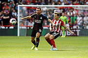 Luke Freeman of Sheffield United passes the ball during the Premier League match between Sheffield United and Crystal Palace at Bramall Lane, Sheffield, England on 18 August 2019.