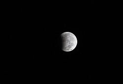 August 8, 2017 - Serpong, South Tangerang, Indonesia - Serpong, 08 August 2017 : Partially Lunar Eclipse seen from South Tangerang-Banten-Indonesia. Onl Partial Eclipse only 25 per cent of the moon's surface will be darkened. (Credit Image: © Donal Husni via ZUMA Wire)
