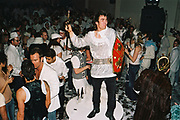 A man dressed as a knight poses at Return to Narnia, Pushca, New Years Eve, 2004