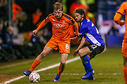 Sheffield Wednesday midfielder George Boyd (21) tries to tackle Luton Town midfielder Luke Berry (8) during the The FA Cup 3rd round replay match between Luton Town and Sheffield Wednesday at Kenilworth Road, Luton, England on 15 January 2019.