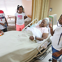 """Destini Hill, 8, of Plantersville, reads """"Judy Moody was in a Mood"""" by Megan McDonald, to Cloteria Cayson, her great grandmother, a resident at Tupelo Nursing and Rehab Center on Monday afternoon. Hill, along with other children, is attending the Red Oak Baptist Church summer reading program and part of a group of children that come to read to the residents of the Nursing and rehab center."""
