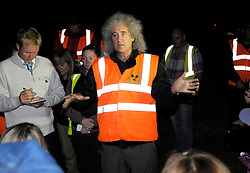 © Licensed to London News Pictures. 06/09/2013. Eldersfield, Gloucestershire, UK.  Brian May speaks to campaigners on the Wounded Badger Patrol when he visited the badger culling zone in West Gloucestershire to lend support to the campaign against the cull.  Brian is an outspoken opponent of the badger cull and has a charity called Save Me.  The Government has licensed a pilot badger cull as part of efforts to reduce boving turberculosis in cows on farms.  06 September 2013.<br /> Photo credit : Simon Chapman/LNP