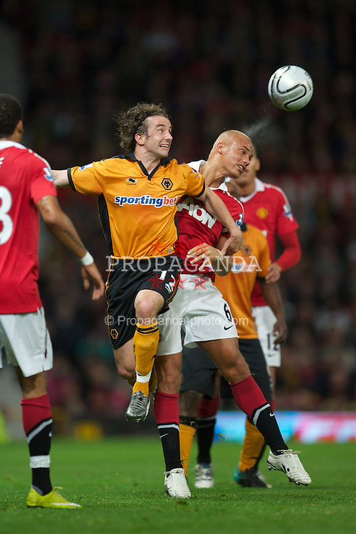 MANCHESTER, ENGLAND - Tuesday, October 26, 2010: Manchester United's Wes Brown and Wolverhampton Wanderers' Stephen Hunt during the Football League Cup 4th Round match at Old Trafford. (Pic by: David Rawcliffe/Propaganda)