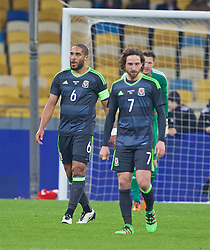 KIEV, UKRAINE - Easter Monday, March 28, 2016: Wales' captain Ashley Williams and Joe Allen look dejected as Ukraine score the opening goal during the International Friendly match at the NSK Olimpiyskyi Stadium. (Pic by David Rawcliffe/Propaganda)