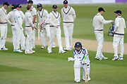 Rilee Rossouw of Hampshire on his knees as Middlesex Celebrate a wicket  during the Specsavers County Champ Div 1 match between Hampshire County Cricket Club and Middlesex County Cricket Club at the Ageas Bowl, Southampton, United Kingdom on 16 April 2017. Photo by David Vokes.