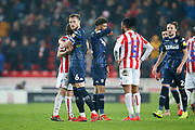Leeds United defender Liam Cooper (6) embraces Stoke City midfielder Joe Allen (4) at full time during the EFL Sky Bet Championship match between Stoke City and Leeds United at the Bet365 Stadium, Stoke-on-Trent, England on 19 January 2019.