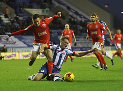 Jake Buxton of Wigan Athletic tackles Jack Payne of Huddersfield Town (L)  - Mandatory by-line: Jack Phillips/JMP - 02/01/2017 - FOOTBALL - DW Stadium - Wigan, England - Wigan Athletic v Huddersfield Town - Football League Championship