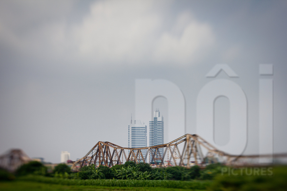 View of Long Bien bridge from Long Bien Island with modern high-rises towering behind it, Hanoi, Vietnam, Southeast Asia