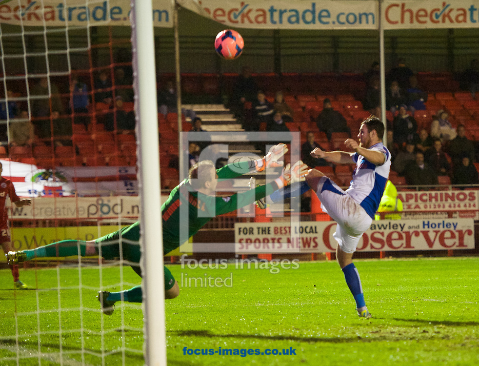 Picture by Alan Stanford/Focus Images Ltd +44 7915 056117<br /> 08/01/2014<br /> Tom Parkes of Bristol Rovers comes close to scoring an own goal past goalkeeper Steve Mildenhall during the The FA Cup match at Broadfield Stadium, Crawley.