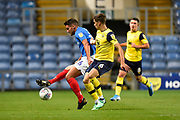 Gareth Evans (26) of Portsmouth battles for possession with Alex Gorrin (6) of Oxford United during the Leasing.com EFL Trophy match between Oxford United and Portsmouth at the Kassam Stadium, Oxford, England on 8 October 2019.
