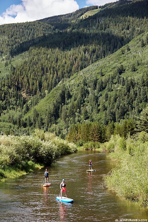 Stand up paddle boarding the Roaring Fork River east of Aspen, Colorado.