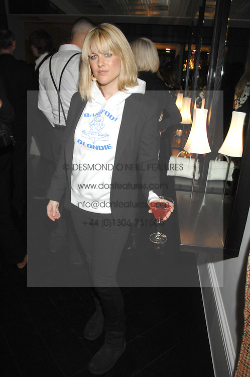 Actress GEORGINA BOUZOVA at the opening party of hairdresser Paul Edmond's new salon at 217 Brompton Road, London SW3 on 18th March 2008.<br />