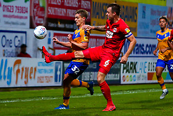 Josh Coulson of Leyton Orient gets the ball away from Danny Rose of Mansfield Town - Mandatory by-line: Ryan Crockett/JMP - 20/08/2019 - FOOTBALL - One Call Stadium - Mansfield, England - Mansfield Town v Leyton Orient - Sky Bet League Two