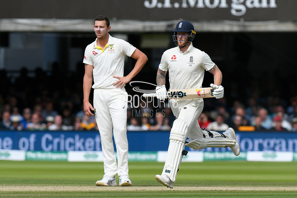 Ben Stokes of England running as Josh Hazlewood of Australia watches on during the International Test Match 2019 match between England and Australia at Lord's Cricket Ground, St John's Wood, United Kingdom on 18 August 2019.