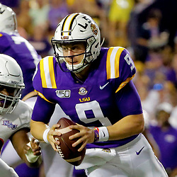 Sep 14, 2019; Baton Rouge, LA, USA; LSU Tigers quarterback Joe Burrow (9) is pressured by Northwestern State Demons nose tackle Damian Thompson (99) during the second quarter at Tiger Stadium. Mandatory Credit: Derick E. Hingle-USA TODAY Sports