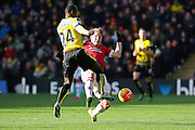 Bastian Schweinsteiger of Manchester United tackles with Odion Ighalo of Watford during the Barclays Premier League match between Watford and Manchester United at Vicarage Road, Watford, England on 21 November 2015. Photo by Phil Duncan.