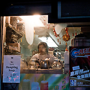 Dumpling soup seller in a chinese small shop