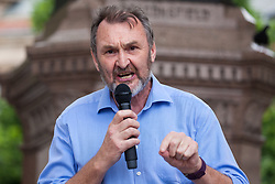 London, UK. 30 May, 2019. Kevin Courtney, Joint General Secretary of the National Education Union (NEU), addresses campaigners from SEND National Crisis attending a demonstration in Parliament Square to demand improvements in the diagnosis and assessment of young people with SEND, assistance for their families, funding and legal and financial accountability for local authorities in their treatment of young people with SEND and their families. Credit: Mark Kerrison/Alamy Live News