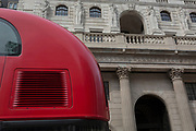 "The rear curvature of a London Routemaster bus and the exterior of the Bank of England on Threadneedle Street in the City of London - the capital's financial district, on 3rd September 2018, in London England. The Bank of England, is the central bank of the United Kingdom and the model on which most modern central banks have been based. Established in 1694, it is the second oldest central bank in the world. Sir Herbert Baker's rebuilding of the Bank, demolishing most of Sir John Soane's earlier building, was described by architectural historian Nikolaus Pevsner as ""the greatest architectural crime, in the City of London, of the twentieth century""."