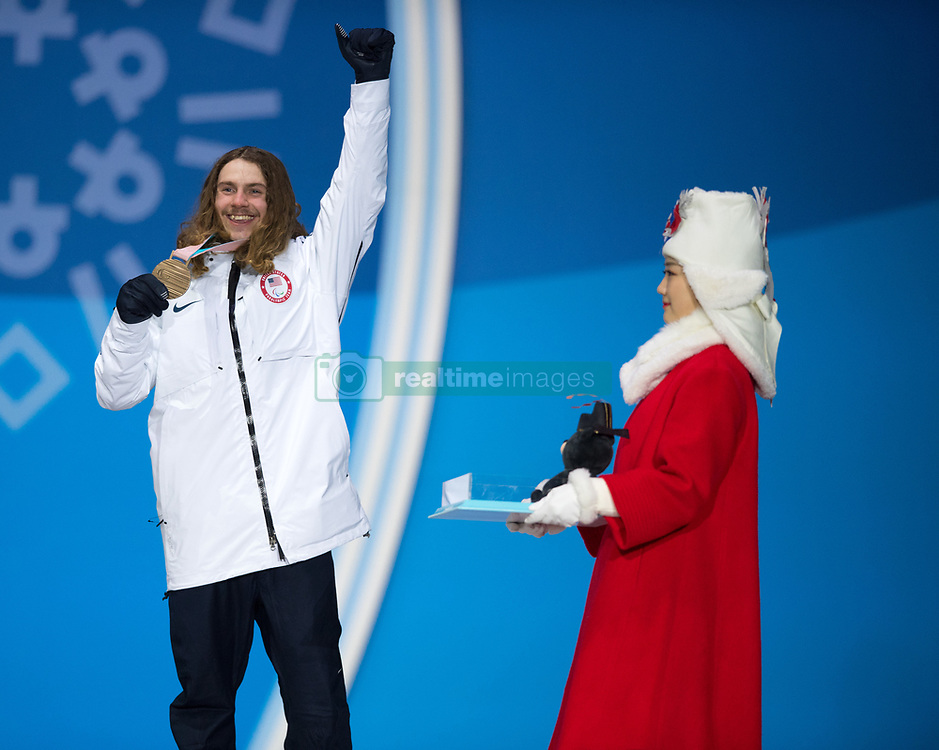 March 12, 2018 - Pyeongchang, South Korea - Bronze medalist Noah Elliott of the US celebrates during a medal ceremony for Men's Snowboard Cross Monday, March 12, 2018 at the Medals Plaza for the 2018 Pyeongchang Winter Paralympic Games. Photo by Mark Reis (Credit Image: © Mark Reis via ZUMA Wire)