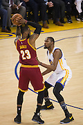 Golden State Warriors forward Kevin Durant (35) defends Cleveland Cavaliers forward LeBron James (23) at Oracle Arena in Oakland, Calif., on January 16, 2017. (Stan Olszewski/Special to S.F. Examiner)