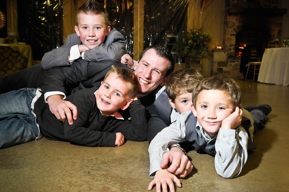 A groom hangs out with his nephews literally on the dance floor at the Audubon Center at Mill Grove, PA.