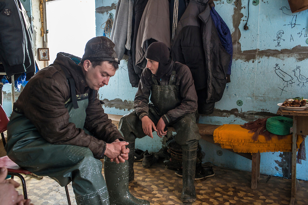 Fishermen during a break on Saturday, April 11, 2015 in Siedove, Ukraine.